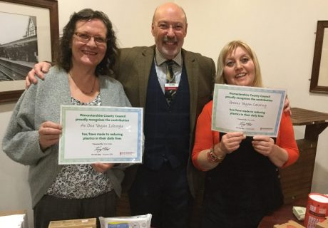 Photo caption (L to R) Lindsey Clode of As One Vegan Lifestyle, and Jude Green of Green's Vegan Café receive their Plastic Pledge awards from Councillor Tony Miller