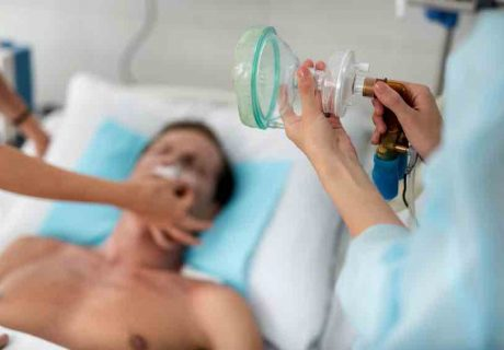 Nurse preparing oxygen mask for patient in critical state