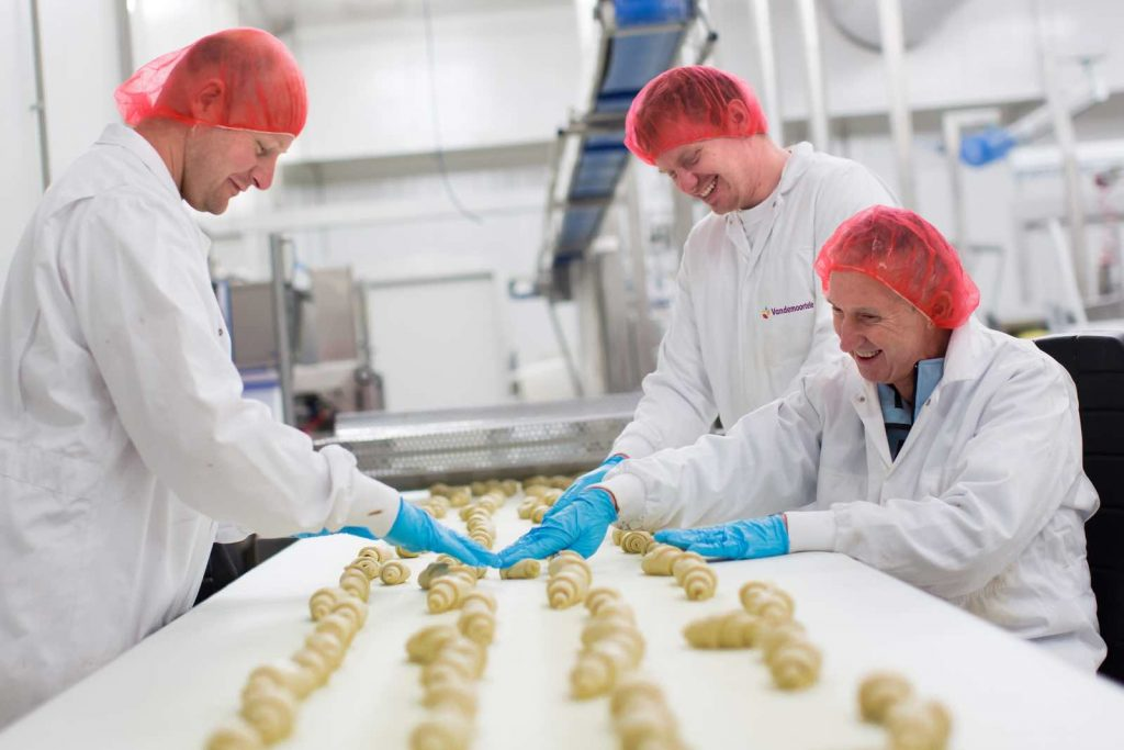 Vandemoortele-Factory workers at croissant production line[4]