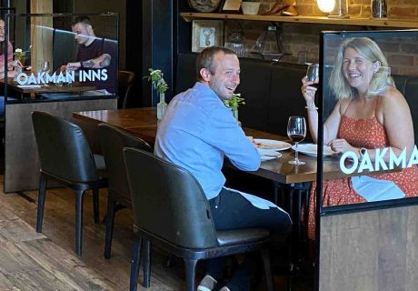 Oakman Inns – guests at tables with glazed screens