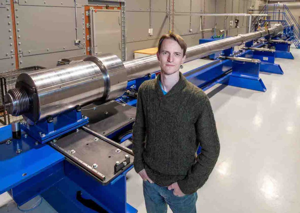 Dr Nick Hawker, CEO of First Light Fusion, in fron of the UK's largest hyper velocity gas gun 2[1]