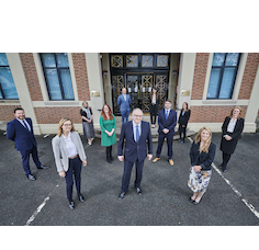Maynard Burton (centre) with newly promoted lawyers from mfg Solicitors LLP