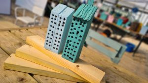 'Insect hotels' created by Guideposts Trust members using donated wood from local company, Stewart Milne Timber Systems.