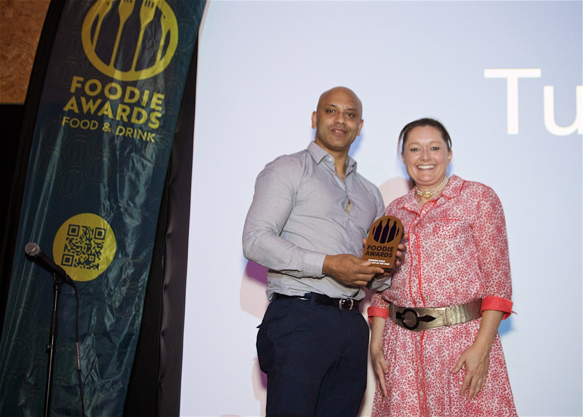 Jay Alam of Turmeric Gold presented with the Restaurant of the Year Award by Steph Kerr